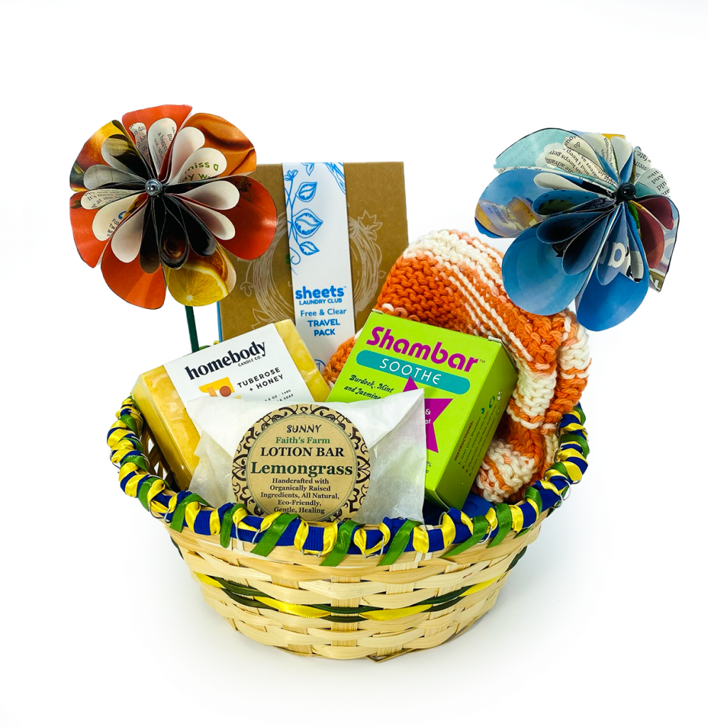 Gift basket with plastic-free bath products and handmade flowers